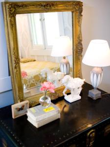 Create you own vanity table by simply placing a decadent mirror on your favorite dresser, table or trunk.